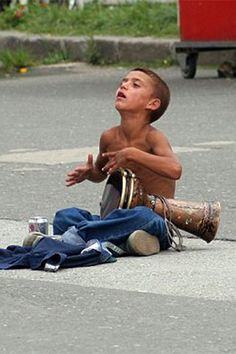 Homeless Greek child featured on the [ Accepting Unacceptable ] article. AND Society - Photo: Getty Images - Children are being dumped on Greece's streets by their poverty-stricken families who cannot afford to look after them any more.