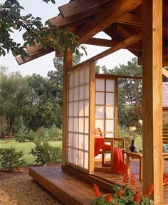 A raised platform deck brings a touch of Asian style to this rural location. Opaque acrylic replaces traditional rice paper in the screen panels and brings a serene intimacy to the space.