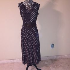 Talbots Brown and White Poka Dot Dress Talbots Brown and White Polka Dot Dress. It has buttons on the left side of the dress as shown in the pic. Talbots Dresses