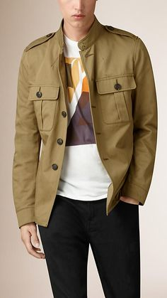 Burberry Khaki brown Cotton Twill Field Jacket - A military-inspired field jacket in lightweight cotton twill. The streamlined design features a hook-and-eye collar, adjustable cuffs and shoulder vents on the back. Heritage references include epaulettes and box-pleat pockets.  Discover the men's outerwear collection at Burberry.com