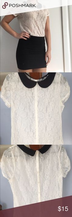 White lace blouse This detailed white lace blouse buttons all the way up the back and has a black collar. The tag says XL but I wear a small and it fits great so I think it may have been meant for younger girls (Warning: it is mostly transparent so I wear a white tank under it) Tops Blouses
