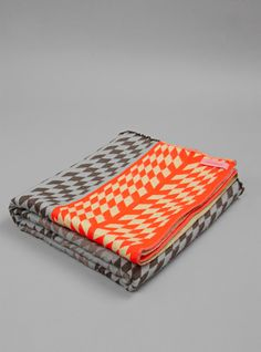 Woww Collection 'Stola' By Mae Engelgeer. Graphic throw made from fabric developed at the Textile Museum in Tilburg, Holland. Overlocked edges with discreet tassel finish at each end. Made in Holland.