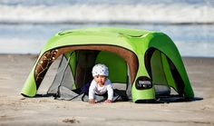 The GOCRIB. It has a sun shade on top, great ventilation and has a mosquito net. Perfect for camping with a baby!