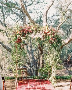 I like the flowers and greenery on this arch way. I like how it looks kind of wild. I wouldn't want the greenery to go all the way down though. I would want some of the wooden arch exposed. I also think tiny pops of yellow may look nice in there too, but I would have to see it to know for sure.