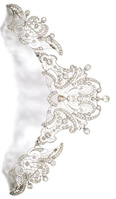 An Edwardian amond tiara/devant de corsage, circa 1910. Of openwork scroll and…