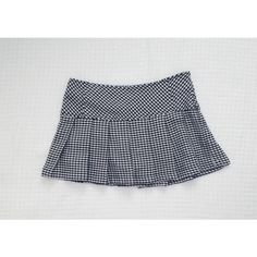 Pleated Houndstooth Tennis Skort Woven black & white houndstooth skort in the tennis/ school girl silhouette. Has stretchy black shorts attached underneath. Zips up on side, and has adjustable straps in waistband. Great condition, only flaw is there is a tiny unnoticeable hole (pictured). Labeled as a size 10/12 in girls, but fits more like a size S in women's. Pretty stretchy as well! Dresses
