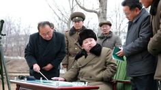 North Korean leader Kim Jong Un gives instruction during a simulated test of atmospheric re-entry of a ballistic missile, at an unidentified location in this undated photo released by North Korea's Korean Central News Agency (KCNA) in Pyongyang on March 15, 2016.