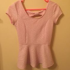 Pink Peplum Top Light Pink Peplum Top. Adorable back. Can wear at casual or formal events.  perfect condition. Charlotte Russe Tops
