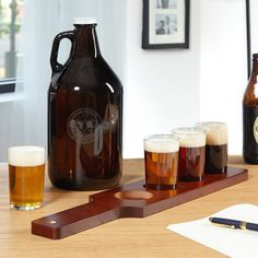 It's often said that the best way to taste beer is in large amounts, and we believe that's true. Host a tasting of your own with our Bierhaus personalized beer flight and growler set. Each of these beer flight sets let you easily compare the taste, color, and quality of up to four beers at a time. You can also fill the entire flight with the same beer, and share with your fellow drinkers. We include a 64 oz. amber glass growler that's engraved with two lines of custom text, and th...