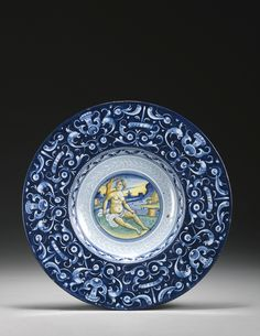A dated Faenza maiolica berettino dish<br>dated 1536 | Lot | Sotheby's
