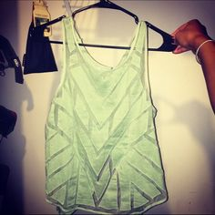 Free people mesh tank! Brand new with tags! Size medium dusty green by free people! Selling because I didn't like the color on me. Free People Tops Tank Tops