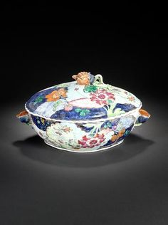 $29,000.00 A famille rose 'tobacco-leaf' oval tureen and cover Qianlong