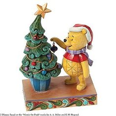 This charming Trim The Tree With Me figurine from Disney Traditions features the lovable Winnie The Pooh getting ready for the festive season. Wearing a cosy scarf & jolly Santa hat, Pooh Bear puts the finishing touch on a gorgeous decorated Christmas tree. The Disney Traditions range of collectibles by Jim Shore brings to life the timeless magic of Disney.