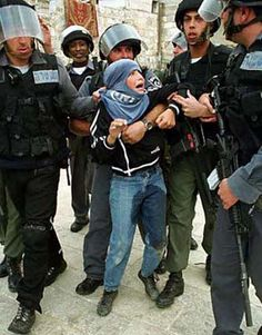 "Israeli soldiers and ""border police"" arresting a  Palestinian Child.  Hundreds of Children are in Israeli jails"
