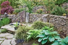 DIY Rock Wall Saves Money Build functional rock walls with rocks you collect.  I love this look!