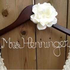 These personalized wooden dress hangers are perfect to hang your wedding dress on, and they make fantastic photo props for your wedding day!