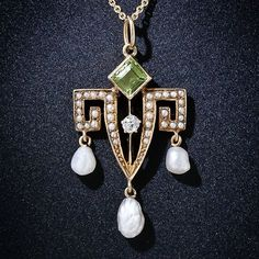 This smart and artsy lavaliere necklace - circa 1900 - incorporates a geometric Greek key motif set with tiny seed pearls in a stunning Art Nouveau design. The very lovely pendant is crowned with a square-cut peridot turned on the bias, centered with a sparkling old mine-cut diamond and culminates with a trio of dancing freshwater pearls by yolanda