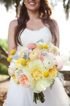 cheerful bouquet featuring wood peonies, garden roses, ranunculus and billy balls by Branch Design Studio