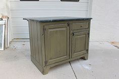 Small kitchen island with seating in back, soapstone top