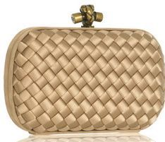 Bottega Veneta clutch has a rigid curved-edge frame and fastens at top with  clasp fastening. cc20283448939
