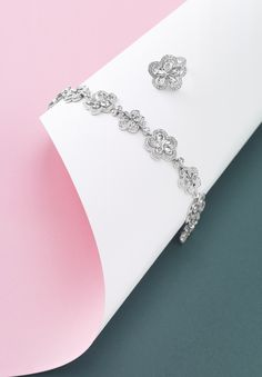 Boodles Blossom Collection - As uplifting as a walk through the blossoming trees, this collection features the Japanese 'sakura' cherry blossom, which has had such a tremendous influence on British design and textiles. The stylised petals glisten with dew, evoking new beginnings and the joy of spring.