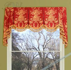 A flat scalloped valance with bells & jabots. The fabric is placed very well.