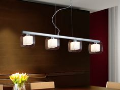Lamp of 4 lights made of steel and metal, chrome finish. Four double glass shades of molded glass, exteriors in clear and interiors in opal glass.