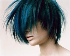 amazing depth of tone to this teal haircolor and a great shattered undercut that helps show them off.
