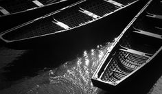 Traditional Irish boats Currach . See the print: http://www.eoingallagher.com/currach-schull.html