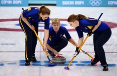 Maria Prytz of Sweden places a stone while Christina Bertrup (L) and Maria Wennerstroem (R) of Sweden sweep during the Gold medal match between Sweden and Canada (c) Getty Images