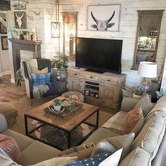 Love the hide rug & mantel