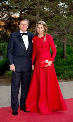 The queen visits Canada and wears a red Valentino dress. Click on the image to see more looks.