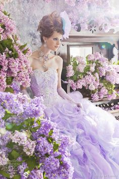 Floral and romantic strapless wedding gown in lilac from Stella de Libero.