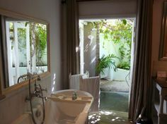 Have a bath inside and your shower outside