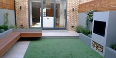 Artificial grass Putney London raised beds hardwood strip trellis travertine paving Dulwich