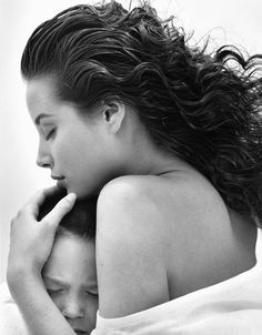 Christy Turlington with a kid for CK Eternity by Bruce Weber