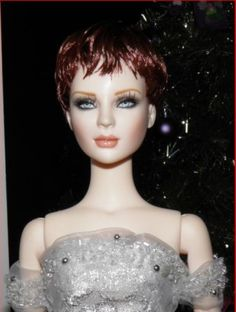 About BJD Ashleigh: Ashleigh wearing a short red Tonner wig