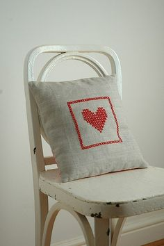 Simple. Lovely. Cross stitch heart in a cushion