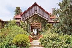 For his retreat in Carpinteria, California, film director Joel Schumacher wanted a rustic look with modern comforts. He called on architect Don Nulty, who created a new residence that incorporated reclaimed barn wood.