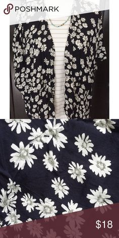 Floral Print Kimono Black with white & gray daisy floral print • has slits on the sides • tag says M but because of its open flowy fit, it could fit most sizes! (OSFM) Tops