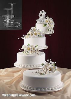 4 Tier Cascade Wedding Cake Stand Stands Set | eBay This one is actually very nice and could work beautifully.
