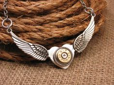 """Love to See the Bullets Fly"" Winged Heart Necklace"