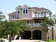 This coastal house plan features 4 bedrooms, 2 master suites with large baths, 3.5 baths, den, wraparound decks, 2 story open foyer, covered porch, vaulted ceiling in living