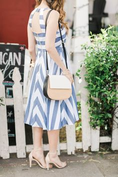 striped blue and white dress with woven kate spade byrdie cameron bag