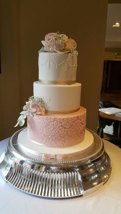 Blush, gold and white wedding cake with sugar flowers, lace and  stencilling