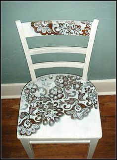 """I cleaned, but didn't sand the chair, then taped a piece of a lace curtain panel across the seat and the larger back bar at an angle to leave some of the area plain. Then I got a can of white spray paint (I used flat paint) and sprayed carefully through the lace,making sure not to spray too heavily, let it dry and then removed the lace. Then I got flat white house paint and painted the rest of the chair white. Finally, I used a small brush to edge (approx. 1/8″) the patterns made by the…"