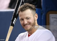 Josh Donaldson #20 of the Toronto Blue Jays smiles as he gets ready to bat while looking on from the top step of the dugout during MLB game action against the Oakland Athletics at Rogers Centre on July 25, 2017 in Toronto, Canada.