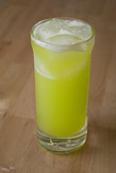 Midori June Bug (1 oz Midori 1/2 oz coconut rum 1/2 oz banana liqueur 2 oz pineapple juice 1 oz lemon juice)