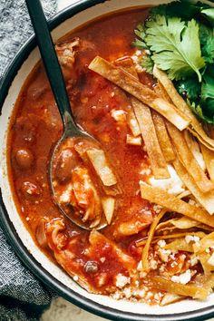 Chicken Tortilla Soup! Winner, winner, Chicken Tortilla Soup dinner! Tender chicken thighs, creamy pinto beans, garlic and onions, crushed tomatoes, jalapeño pepper, crushed tomatoes, and ALL the toppings. #chickentortillasoup #recipe #soup