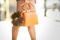 orange leather #bag x furry monster keychain :: Peekaboo by #Fendi